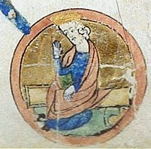 A circular medieval miniature, showing a man in blue robes, with long flowing hair and a short beard.
