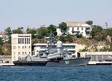 Grey military ship with missiles