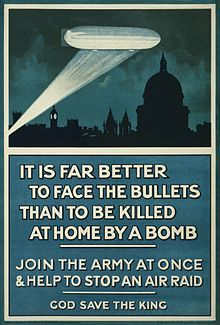 """Poster: picture of Zeppelin illuminated by searchlight over silhouetted London skyline; headline: """"IT IS FAR BETTER TO FACE THE BULLETS THAN TO BE KILLED AT HOME BY A BOMB"""""""