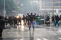 Police and protesters stand off in Seattle on May 30