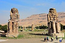 Two huge statues of seated figures