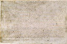 A photograph of a page of Magna Carta, a wide page of dense, small medieval writing.