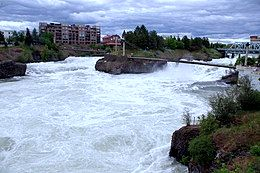 The Spokane River rushes passed Canada Island in Riverfront Park