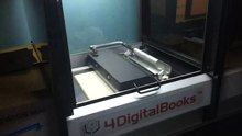 File:Robotický knižní scanner.webm
