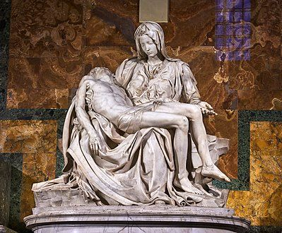 This marble statue shows the Virgin Mary seated, mourning over the lifeless body of Jesus which is supported across her knees.