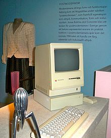 A Macintosh sits in a museum exhibit about postmodernism.