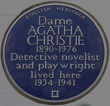 """Colour photograph of a wall plaque stating Christie """"lived here 1934–1941"""""""