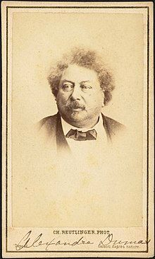 """Photograph of Alexandre Dumas wearing a bowtie and looking slightly off camera. A typed caption at the bottom of the image reads """"Ch. Reutlinger Phot."""" and an annotation in pencil denotes the name of the subject."""