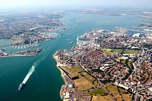 An aerial view of western side of Portsmouth (including Gunwharf Quays, the dockyard and the Spinnaker tower), the harbour itself, and the town of Gosport