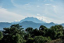 Mount Kinabalu seen from the top of a pagoda