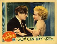 Color lobby card of Barrymore facing Carole Lombard and holding her roughly by the arms, as if scolding her (the other photos are black and white)