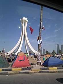 Protesters camped out infront of the Pearl Roundabout in Bahrain.jpg
