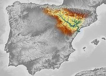 Black and white satellite image of the Iberian Peninsula, but the Ebro River valley at the Spain/France border uses red to blue colours to indicate topography and elevation