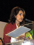 Photograph of a modern Pontic Greek woman at a podium.