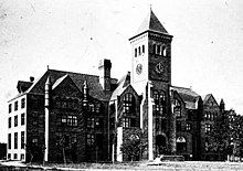 Early 20th-century black-and-white photo of three-story building