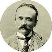 Head and shoulder shot of middle-aged man, moustached, slightly balding