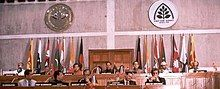 Leaders seated at a dais