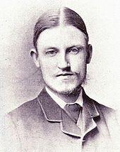 young man with faint, wispy beard