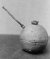 A unexploded dynamite bomb with fuse.