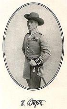 A man posing in an old uniform