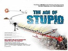 """A red timeline leads from the past into a ruined city scape. The film title """"The Age of Stupid"""" is shown on the upper right in block capital blue writing"""