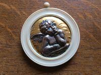 Vends ancienne médaille de berceau angelot