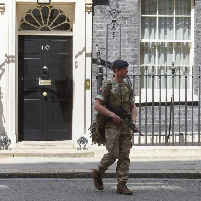 UK security threat level lowered as police close in on bomber's suspected network