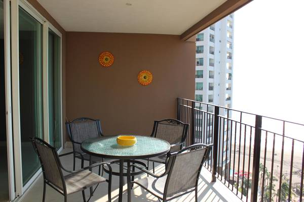 Spacious patio with outside furniture