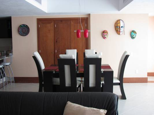 View of the dining area, table, and decor from the couch