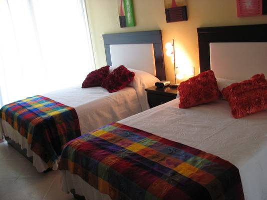 2nd bedroom with different bed covering and decor