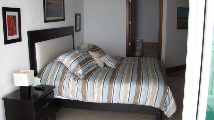 4th bedroom with spacious bed and bathroom door open