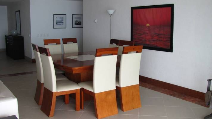 Beautiful and neat dinning room with amazing painting of the sunset