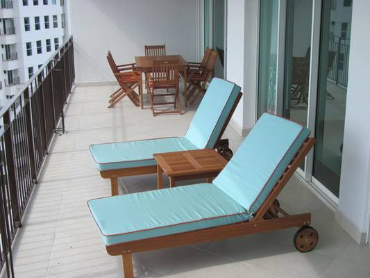 Stylish tanning chairs on the balcony