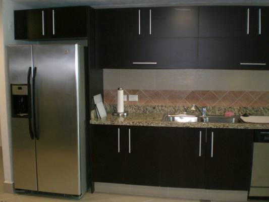 Modern and spacious kitchen with fridge