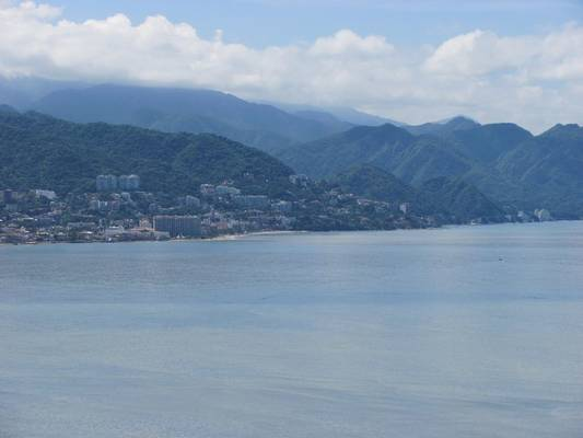 Enjoy this stunning view of the mountains and the ocean from your condo