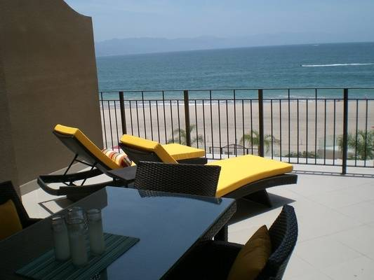 Beautiful and comfy tanning chairs with an oceanfront view