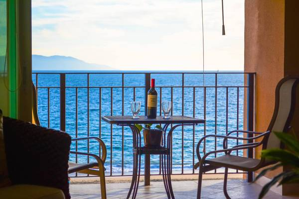 Enjoy astonishing oceanfront views with a glass of wine on your deck