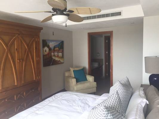 Beautiful master bedroom with fan and bathroom door open