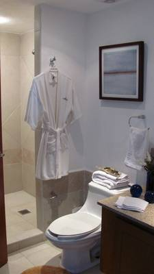 Bathroom with prepped towels, essentials and bathrobe