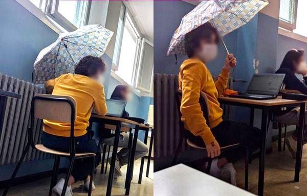 Ombrello aperto in classe, studenti fanno lezione al gelo. Finestre aperte per evitare contagi Covid