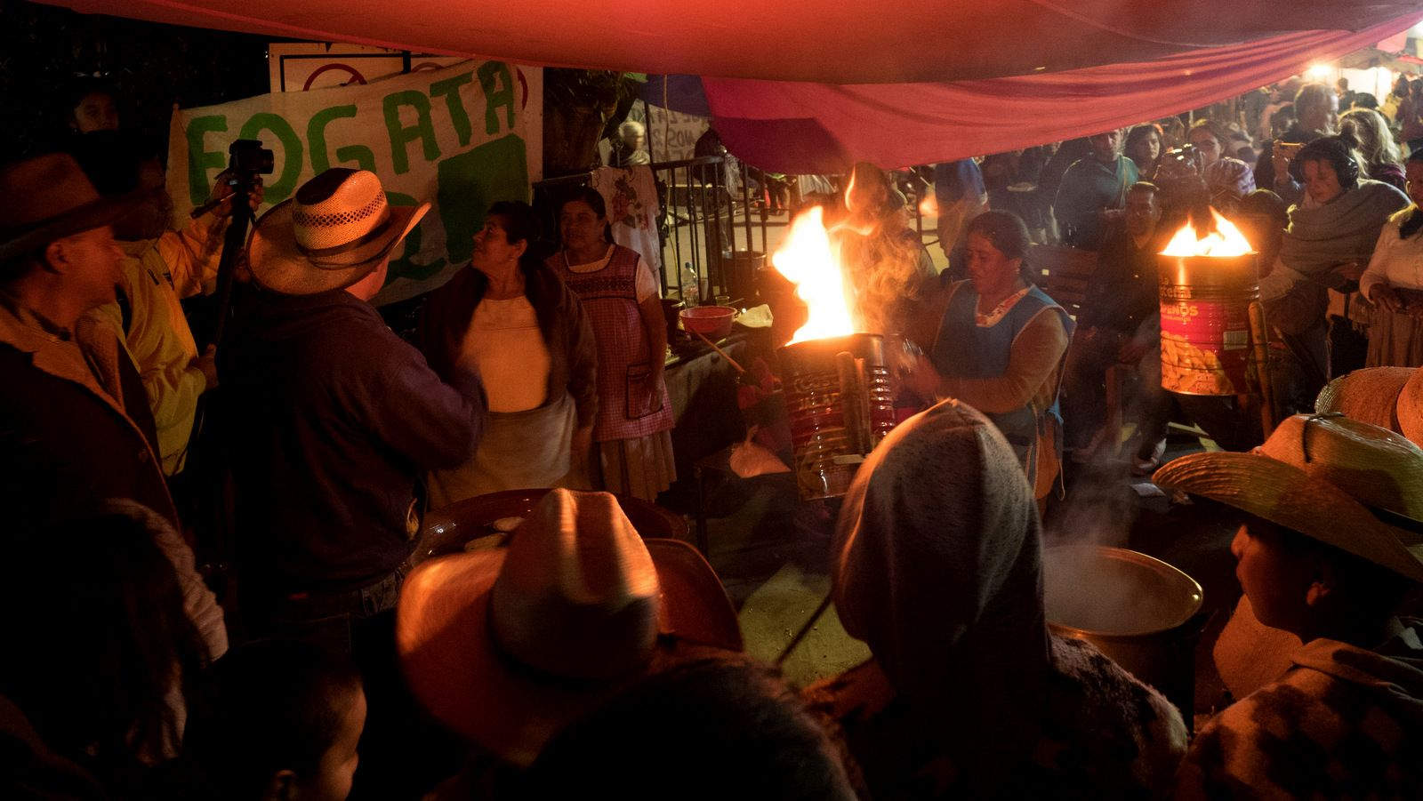 A small crowd visits one of the local bonfires, a part of events commemorating the seventh anniversary of the community uprising against illegal loggers and organized crime in Cheran, Michoacan, April 15, 2018. (Photo: José Luis Granados Ceja)