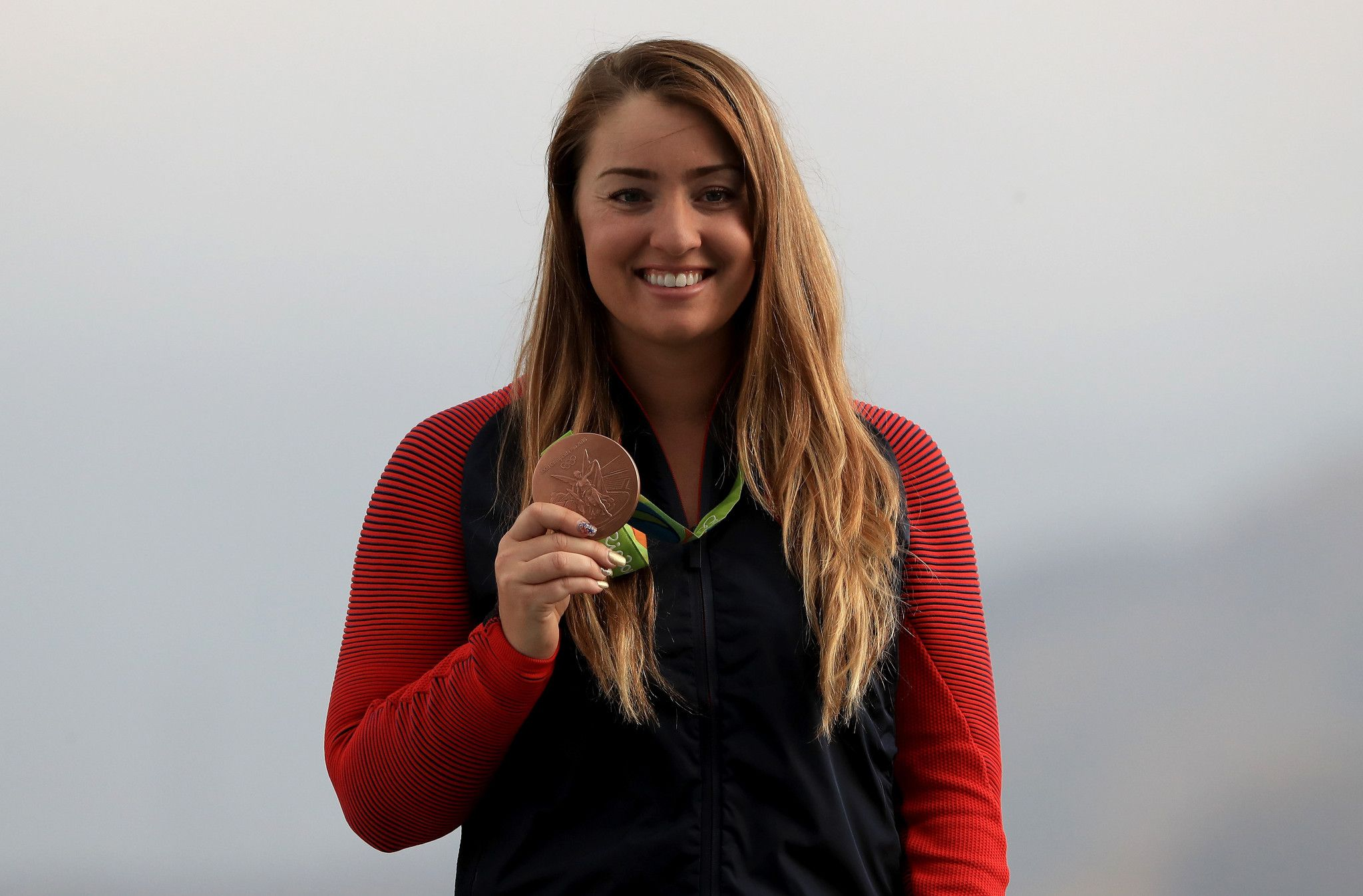 Corey Cogdell, wife of Bears lineman Mitch Unrein, wins bronze in Rio