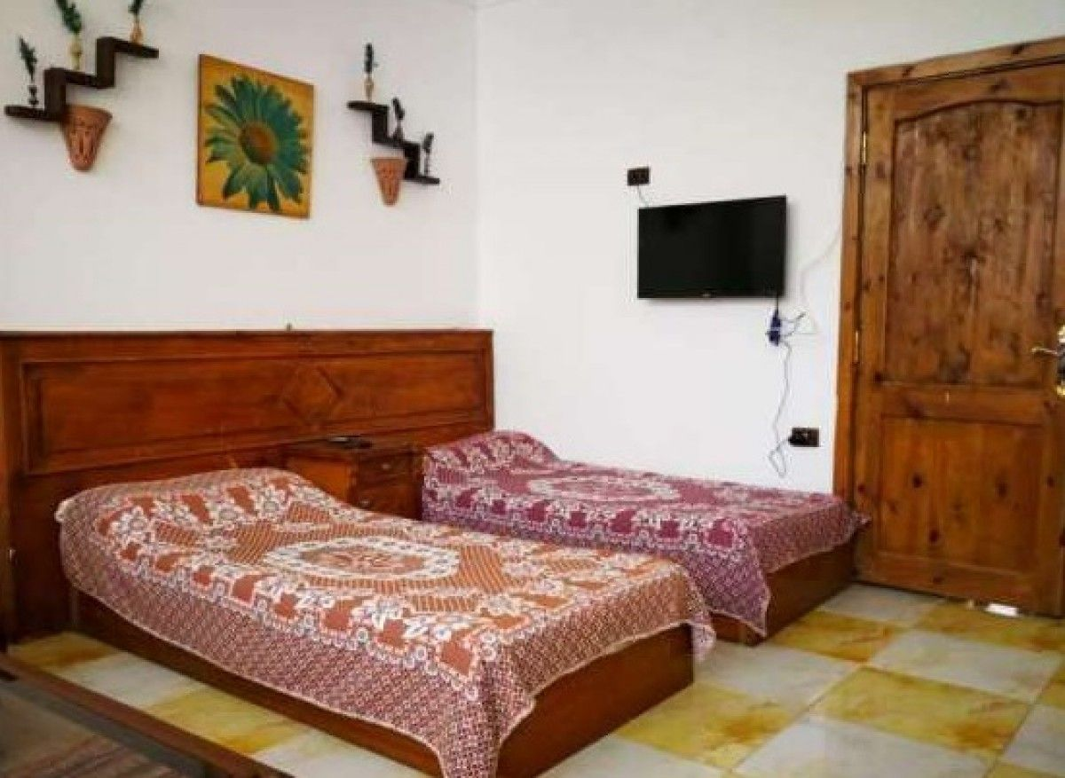 Charming private room in nice villa with swimming poolشقة مفروشة دهب