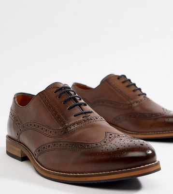 ASOS DESIGN Wide Fit brogue shoes in brown leather with natural sole and navy details